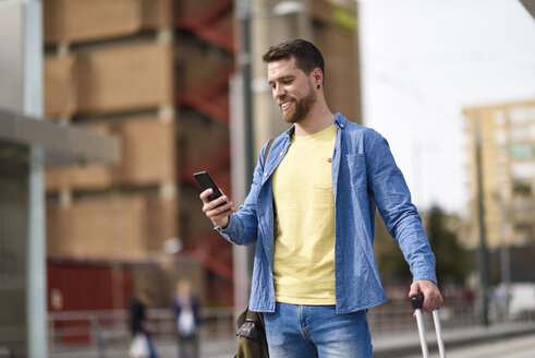 Young man with smartphone at station - JSMF00158