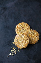 Three granola cookies on dark ground - CSF29126