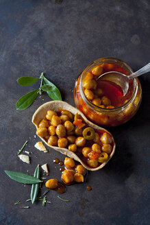 Chick-pea stew with green olives in glass and edible bowl - CSF29150