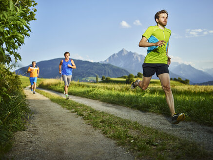 Athletes running on field path - CVF00330