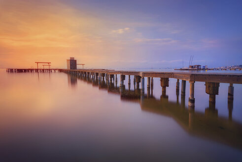 Spain, La Manga del Mar Menor, pier at sunrise - DHCF00187