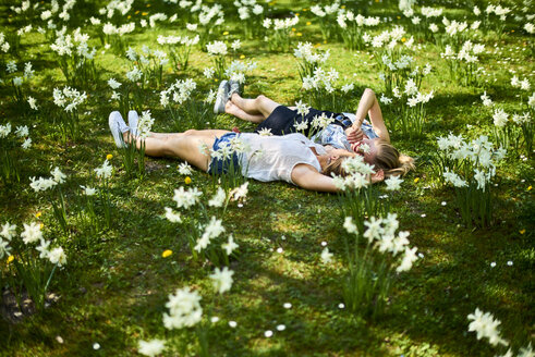 Two friends relaxing on flower meadow - BEF00008