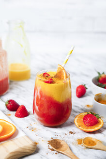 Strawberry and orange smoothie with curcuma and cinnamon on marble - RTBF01237
