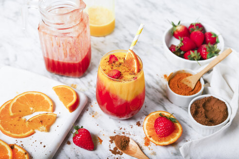 Strawberry and orange smoothie with curcuma and cinnamon on marble - RTBF01240