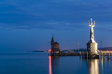 Germany, Constance, view to port entrance with lighthouse and Imperia at twilight - WDF04646