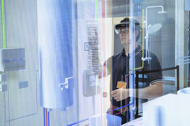 Engineer using augmented reality headset to 'see' utilities through walls in robotics research facility - CUF00033