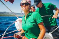 Young woman and men yachting near coast, Croatia - ISF00020