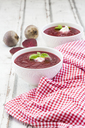 Beetroot soup in bowl on white wood - LVF06922