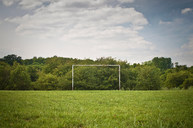Soccer goal on grassy pitch - CUF00651