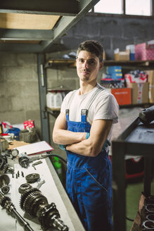 Portrait of confident mechanic in his workshop - RAEF02018