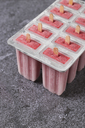 Homemade strawberry ice lollies in tray - RTBF01245