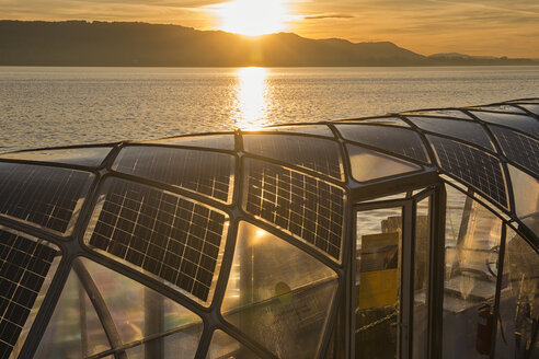 Germany, Baden-Wuerttemberg, Radolfzell, Lake Constance, solar cells on roof of ferry at sunset - SH02030