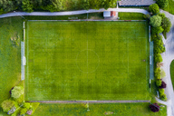 Germany, Baden-Wuerttemberg, Rems-Murr-Kreis, Aerial view of football ground - STSF01521