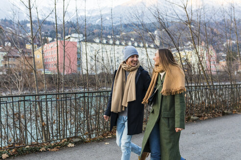 Austria, Innsbruck, happy young couple strolling together at winter time - WPEF00228