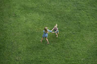 Bird's eye view of mother and daughter having fun in garden - SBOF01486