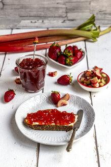 Breakfast table with strawberry rhubarb marmelade, strawberries and rhubarb - SARF03708