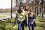Happy family walking in a park - DIGF04145