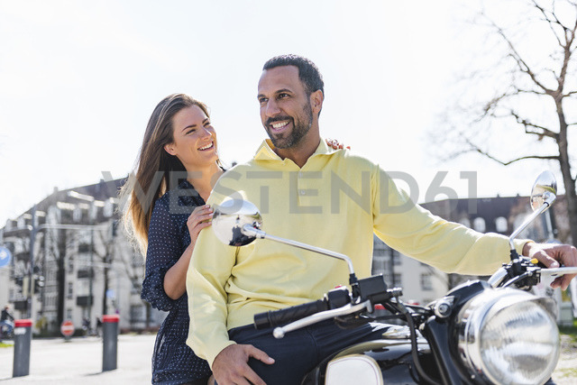 Happy couple on a motorbike - DIGF04154