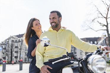 Happy couple on a motorbike - DIGF04154