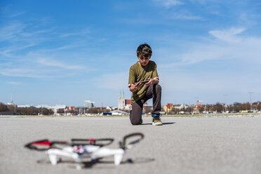 Boy flying drone - DIGF04169
