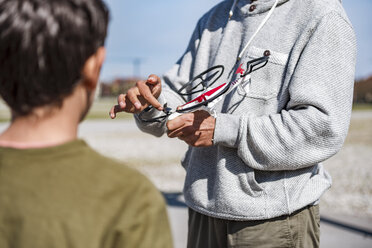 Father and son flying drone - DIGF04172