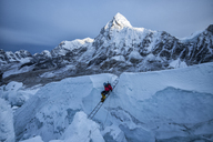 Nepal, Solo Khumbu, Mountaineer at Everest Icefall, Pumori in background - ALRF01128