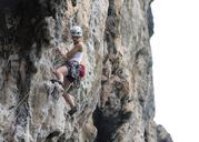 Thailand, Krabi, Chong Pli, woman climbing in rock wall - ALRF01167