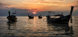 Thailand, Krabi, Railay beach, long-tail boats floating on water at sunset - ALRF01176