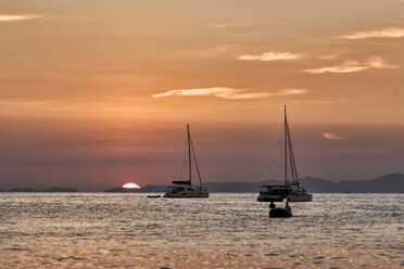 Thailand, Krabi, Railay beach, boats floating on water at sunset - ALRF01191