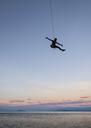Thailand, Krabi, Lao Liang island, climber abseiling above the sea - ALRF01194