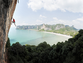 Thailand, Krabi, Thaiwand wall, man climbing in rock wall above the sea - ALRF01200