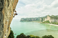 Thailand, Krabi, Thaiwand wall, woman climbing in rock wall above the sea - ALRF01203