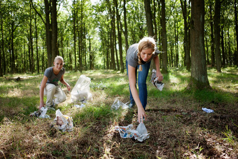 Two young women picking up trash - CUF00963