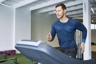 Man running on treadmill at gym - BSZF00333