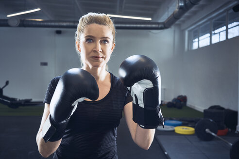 Portrait of woman practicing boxing at gym - BSZF00360