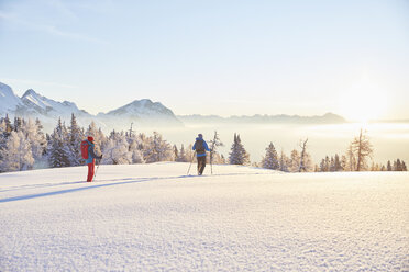 Austria, Tyrol, snowshoe hikers at sunrise - CVF00408