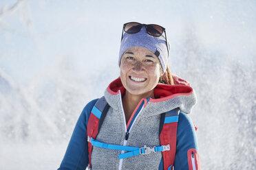 Austria, Tyrol, Portrait of smiling snowshoe hiker - CVF00423