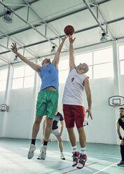 Men playing basketball, defence - ZEDF01356
