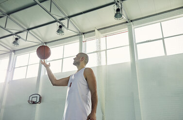 Man playing with basketball, indoor - ZEDF01368