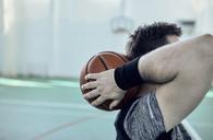 Man with basketball behind head, indoor - ZEDF01374