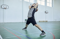Man with basketball, stretching, indoor - ZEDF01380