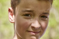 Portrait of sweating boy outdoors - ZEDF01391