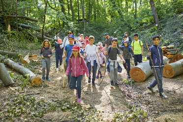 Adults and kids on a field trip in forest - ZEDF01394