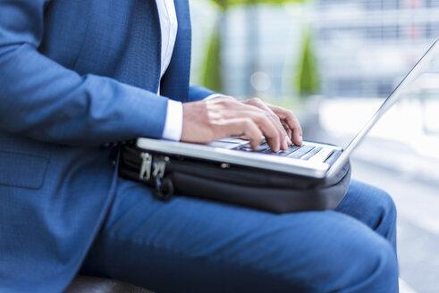 Businessman using laptop - DIGF04196