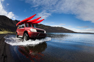Jeep driving in shallow lake - CUF01359
