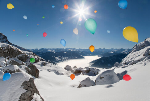 Balloons flying over winter landscape - CUF01416