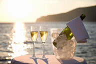Two glasses of champagne at sunset - CUF01630