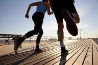 Two people running on promenade - ISF00433