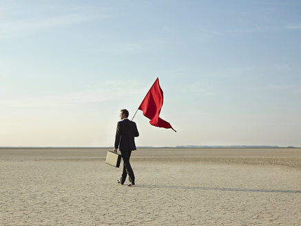 Businessman holding a red flag - ISF00592