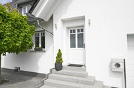 Germany, Cologne, entrance of white new built one-family house - PDF01629